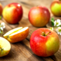 Raw organic apples on wooden background